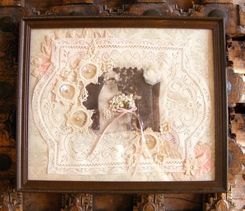 Mixed media collage designed with antique lace, restored photograph and vintage paper